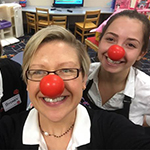 Little Y Employees Wearing Red Noses